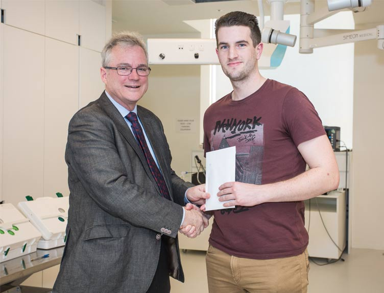 Professor Ronan O'Connell, Vice-President of RCSI, congratulates Ciarán Nannery from the University of Limerick who was the overall winner of the 2019 National Surgical Skills Competition