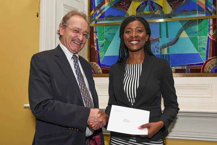 Professor David Smith, Associate Professor of Healthcare Ethics at RCSI presents the 2017/18 Ethics Challenge prize to medical student Moyowa Boyo.